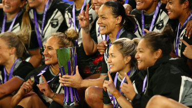 Kiwi Ferns captain Honey Hireme (with the trophy) and her teammates celebrate their thrilling win on Saturday night.