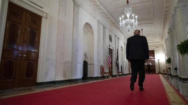 US President Donald Trump seen walking through the White House.