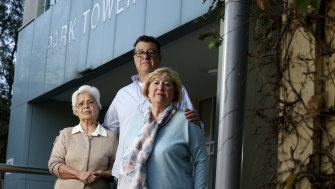 Albertina Martins, John Lowndes and Felicia Benga are residents of  South Melbourne's Park Towers. Mr Lowndes said the two women often cleaned their hallways and their level's laundry rooms - something GJK is contracted to do.