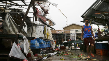 A resident walks along destroyed stalls at a public market due to strong winds as typhoon Mangkhut barrelled across Tuguegrao in Cagayan province, Philippines.