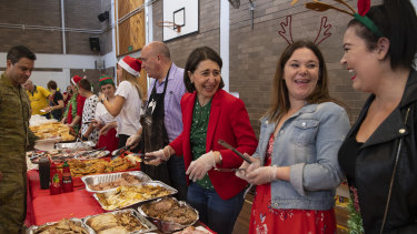NSW Premier Gladys Berejiklian serving breakfast to RFS volunteers at Colo Heights High School on Christmas morning.