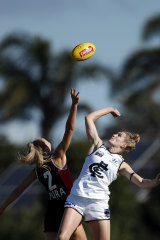 Alison Brown and Breann Moody clash in the ruck.