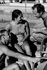 Australian sprint hopes for Rome, Jon Hanricks and Dawn Fraser chat with coach Harry Gallagher later in 1960.