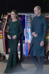 Britain's Prince William and his wife Kate arrive in a traditionally painted motorised rickshaw to attend a reception in Islamabad, Pakistan in 2017.