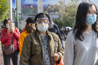 Residents in Hong Kong on Saturday line up to buy more protective masks.