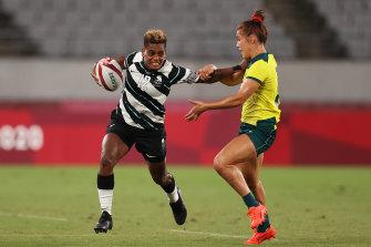 Fiji's Roela Radiniyavuni puts a fend on an Australian defender.