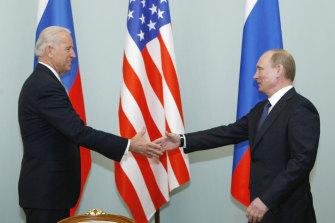 Joe Biden and Vladimir Putin shake hands in Moscow in 2011. The pair will meet again next month.