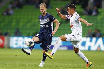 Migjen Basha, left, controls the ball.