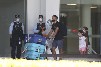 Australians who were stranded overseas arrive in Canberra after a repatriation flight from Singapore in November.
