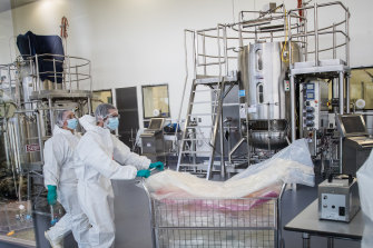 Scientists working in CSL's production facility for the AstraZeneca vaccine on Thursday.