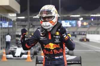 Max Verstappen celebrates taking pole.