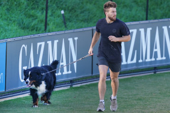 Jack Viney of the Demons trains with his dog Sebastian in Elsternwick.