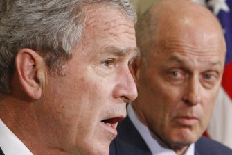 Then-treasury secretary Henry Paulson (right) with then-president George W. Bush at a White House briefing in 2007.
