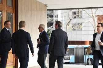 Men arrive at the men's only Australian Club which is holding a vote to determine if women can become permanent members.