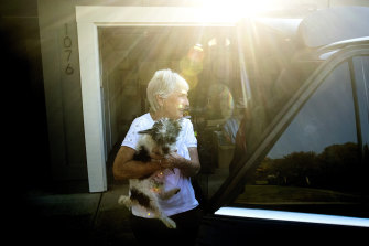 Barbara Sereni helps a neighbour evacuate her dog ahead of the Kincade Fire burning nearby on Saturday in Healdsburg, California.