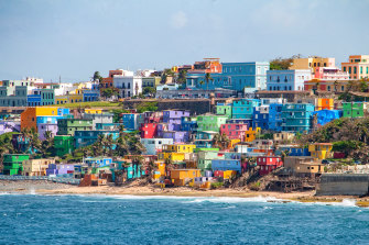 Colourful houses line the hillside over looking the beach in San Juan, Puerto Rico.