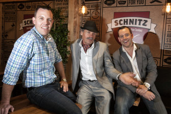 Schnitz founder Roman Dyduk (centre) with his sons Tom and Andrew.