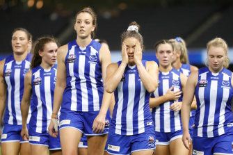 Emma Kearney looks dismayed as she leads the Kangaroos off after they failed to kick a goal in their loss to Collingwood.