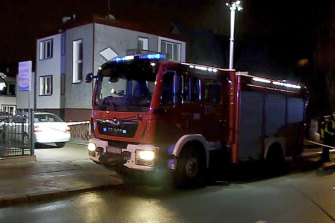 A fire engine outside an escape room in Koszalin, northern Poland that was engulfed by fire.