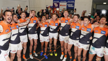 Badlam: GWS players sing the club song after beating Collingwood to qualify for their first grand final.