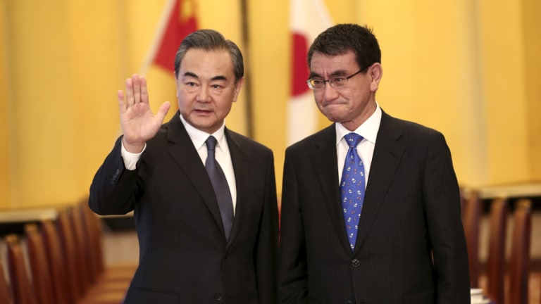 Chinese Foreign Minister Wang Yi and his Japanese counterpart Taro Kono in Tokyo on Sunday.