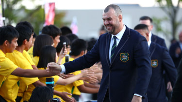 Local children greet Wallabies coach Michael Cheika before the official welcoming ceremony on Wednesday.