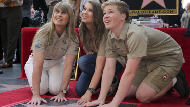 Robert Irwin from right, Bindi Irwin and Terri Irwin pose while touching the star at the ceremony honoring Steve Irwin with a posthumous star on the Hollywood Walk of Fame on Thursday, April 26, 2018, in Los Angeles.