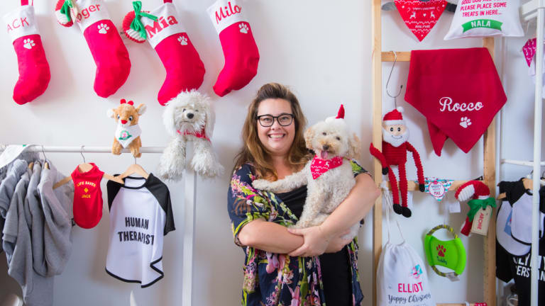 IDPet founder Katrina Thomson, with Sid, with some of the products she sells for Christmas.