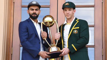India captain Virat Kohli and Australia's Tim Paine with the Border-Gavaskar trophy at the Adelaide Oval on Wednesday.