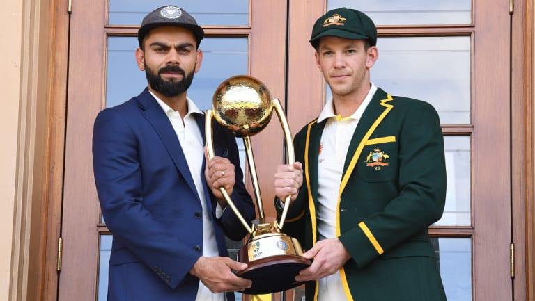 India captain Virat Kohli and Australia's Tim Paine with the Border-Gavaskar trophy at the Adelaide Oval on Wednesday.
