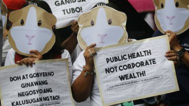 Protesters wear Guinea Pig masks to condemn the controversial immunisation of more than 700,000 Filipino children with the anti-dengue vaccine Dengvaxia in Manila, Philippines on December 18, 2017.