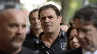 John Setka (centre) at a court hearing in 2016.