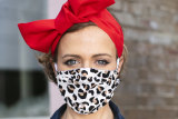 Milliner Chantelle Ford in one of her face masks she has started making in response to the pandemic.