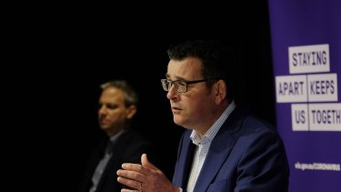 Daniel Andrews and Brett Sutton facing the public yesterday.