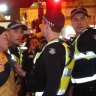 Police bitten, headbutted after dozens ejected from the AFL grand final