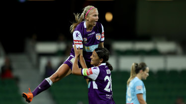High-flyers: Alyssa Mautz (left) and Sam Kerr celebrate in Perth's 5-2 romp against Melbourne City.