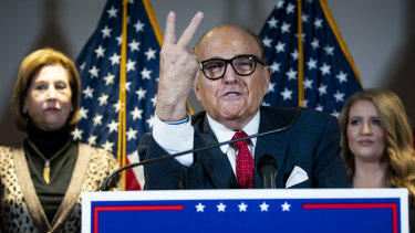 Rudy Giuliani, personal lawyer to US President Donald Trump, spreads a conspiracy theory during a press conference.