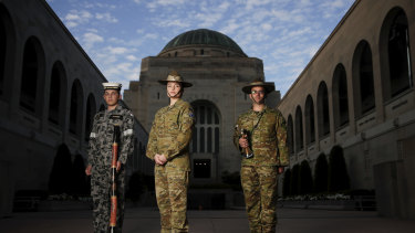 Rachel MacCallum (centre) will sing the national anthem with the Australian Army band at an empty War Memorial in Canberra.