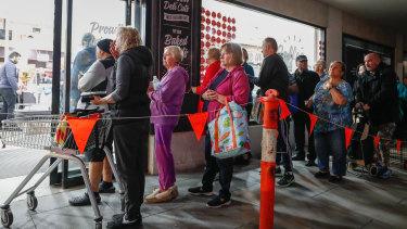 The queue at Altona IGA before dawn on Tuesday.