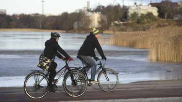 Cyclists enjoy a sunny New Year's Day in Helsinki.