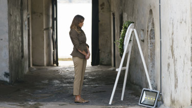 Melania Trump  at one of the dungeon doors at Cape Coast Castle.