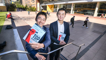Adam Ma, left, invited last year's top HSC achievers to share their study tips in his new book. Tim Yang, who was first in the state in business studies, was among them.