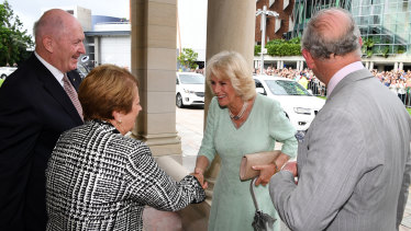 Prince Charles and the Duchess of Cornwall are greeted by the Governor General Sir Peter Cosgrove and his wife Lynne.
