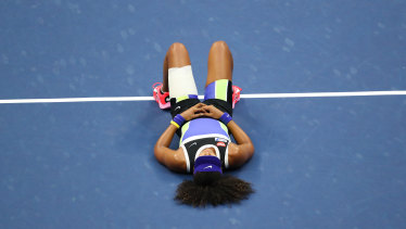 Naomi Osaka of Japan lays down in celebration after winning her Women's Singles final match against Victoria Azarenka of Belarus on Day Thirteen of the 2020 US Open at the USTA Billie Jean King National Tennis Center on September 12, 2020 in the Queens borough of New York City.