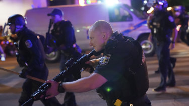 Police move after a Louisville Police officer was shot.