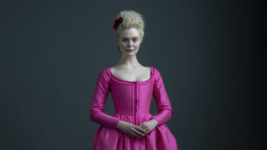 Fanning, pretty in pink, as Catherine the Great, Empress of Russia.
