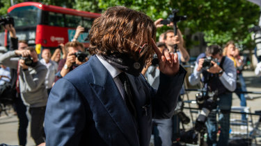 Johnny Depp arrives at The Royal Courts of Justice in London on Tuesday.