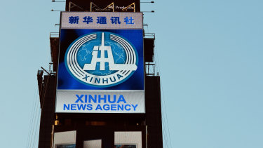 Chinese news agency Xinhua is advertised in New York's Times Square.