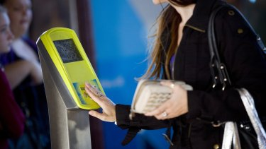 Passenger using a myki card at Clifton Hill station.
