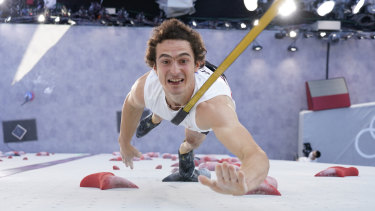 Adam Ondra, of the Czech Republic, participates during the speed qualification section of the men's sport climbing.